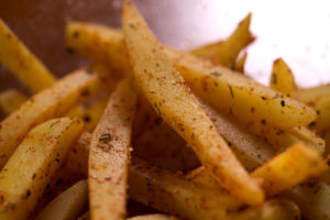 Fries coated with spices